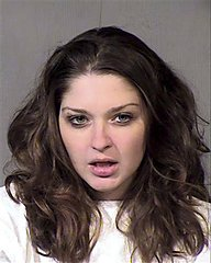 Koko Nicole Anderson, 21, from Mesa, Ariz., is shown after being jailed on aggravated DUI and criminal damage charges in this handout photo provided by the Maricopa County Sheriff's Office on Friday, Nov. 16, 2012. Anderson was charged after crashing her car through a gate at Phoenix Sky Harbor International Airport Thursday night, driving on the runway in the latest in a series of similar mishaps across the country that have raised questions whether the nation's airports are truly secure.